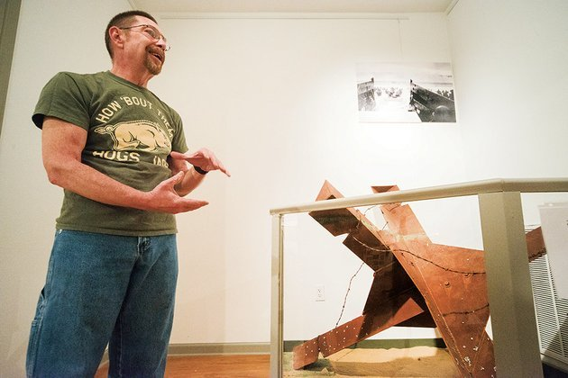 standing-in-front-of-a-model-of-a-czech-hedgehog-anti-tank-obstacle-he-constructed-robert-houston-talks-about-the-d-day-exhibit-he-is-working-on-to-display-at-the-jacksonville-museum-of-military-history