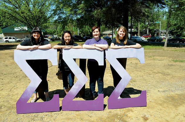 members-and-an-alumna-of-sigma-sigma-sigma-sorority-at-the-university-of-central-arkansas-in-conway-stand-with-their-greek-letters-on-the-site-where-their-chapter-house-will-be-built-as-part-of-the-greek-village-from-left-are-hannah-mccallister-of-benton-a-sophomore-jordyn-kaga-of-maui-hawaii-a-junior-kimberly-irizarry-of-little-rock-an-alumna-and-nicole-turney-of-greenbrier-a-sophomore