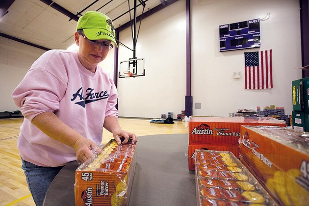 mayflower-high-school-teacher-cindy-webb-opens-boxes-of-crackers-in-the-middle-school-gym-on-april-28-the-day-after-a-deadly-tornado-hit-faulkner-county-teachers-students-and-staff-worked-hard-sorting-donations-and-cleaning-up-the-community-mayflower-school-district-superintendent-john-gray-said-the-state-board-of-education-has-granted-waivers-to-the-mayflower-and-vilonia-school-districts-for-the-five-days-they-missed-school-because-of-the-tornado