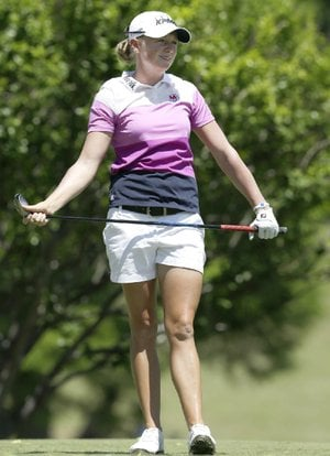 "Former Arkansas Razorbacks golfer Stacy Lewis has a chance to become the top-ranked women's golfer in the world this week, but she isn't focusing on her ranking. ""My number one goal is to win tournaments,"" Lewis said. ""Obviously the rankings and the money list, everything like that takes care of itself. The goal doesn't change: win tournaments."""