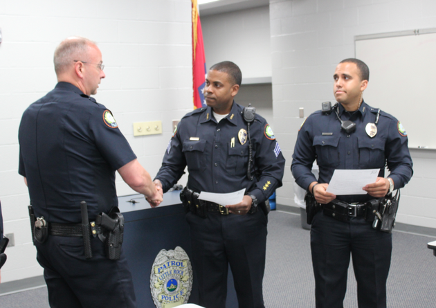 little-rock-police-department-capt-ty-tyrrell-left-shakes-hands-with-sgt-brian-grigsby-on-thursday-after-presenting-letters-of-commendation-to-grigsby-and-officer-troy-dillard-right-for-their-work-in-finding-a-missing-man-and-then-helping-him-buy-mothers-day-flowers-for-his-wife