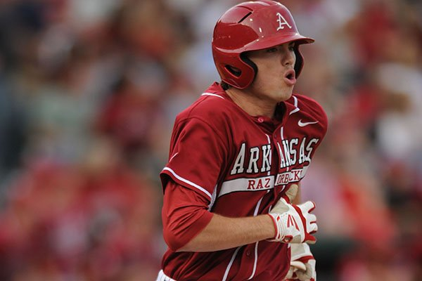Arkansas designated hitter Clark Eagan heads to first after hitting a solo home run against Texas A&M during the third inning Friday, May 9, 2014, at Baum Stadium in Fayetteville.