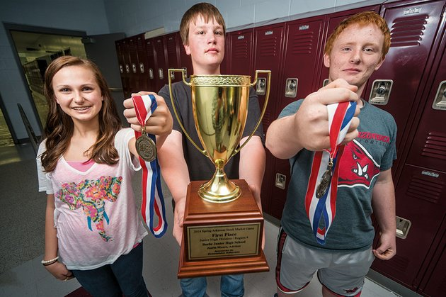 ashley-courson-from-left-derrek-newell-and-shannon-anderson-were-part-of-the-beebe-high-school-teams-that-received-cash-awards-and-trophies-for-winning-first-and-second-place-during-the-spring-2014-session-of-the-stock-market-game-a-project-based-investment-simulation-that-teaches-the-importance-of-saving-and-investing-for-the-future