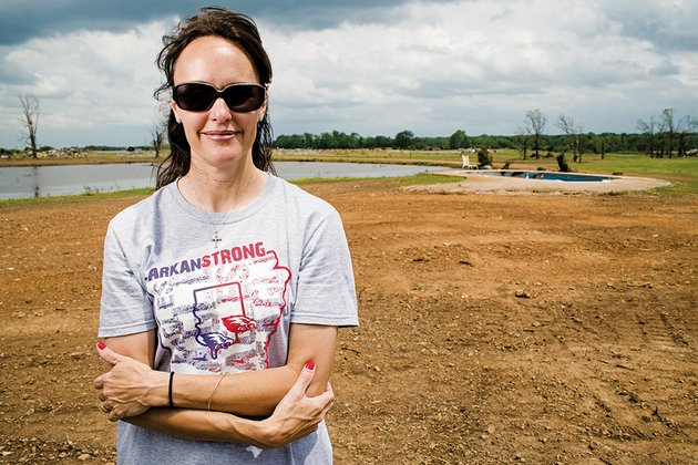 lori-patterson-stands-on-the-lot-in-vilonia-where-her-home-was-before-it-was-hit-by-the-april-27-tornado-the-debris-has-been-cleared-the-only-thing-left-is-a-storm-shelter-and-a-damaged-inground-pool-pattersons-husband-teddy-died-five-years-ago-this-month-and-a-photo-of-him-was-found-in-a-yard-in-batesville-after-the-storm-tore-through-faulkner-county