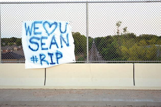 this-banner-was-hung-on-the-salem-road-overpass-in-conway-above-the-railroad-tracks-where-sean-studler-17-was-killed-as-he-walked-west-from-his-neighborhood-which-can-be-seen-at-left-in-the-photo-members-of-his-family-said-they-dont-know-who-put-up-the-banner-which-has-since-been-destroyed-by-rain