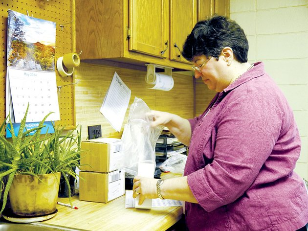 cherie-bradley-prepares-soil-samples-to-be-sent-to-the-agricultural-testing-lab-in-marianna-the-white-county-cooperative-extension-service-provides-free-soil-testing-for-residents-in-preparation-for-their-gardening-projects