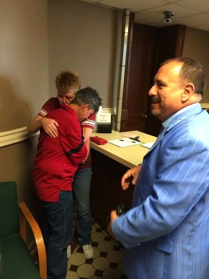 Hilda Jones and Kerin Hartsell embrace Friday afternoon, May 16, 2014, after being issued a marriage license at the Pulaski County Courthouse just moments before the state Supreme Court stayed a ruling that overturned the state's ban on gay marriages.