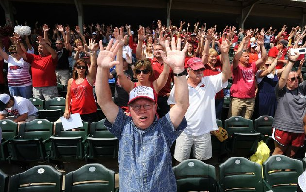 nwa-mediaandy-shupe-rob-leflar-leads-the-crowd-in-a-hog-call-in-the-seventh-inning-stretch-during-a-university-of-arkansas-baseball-game-sunday-may-11-2014-at-baum-stadium-in-fayetteville-in-addition-to-being-a-professor-of-law-and-researcher-at-the-university-of-arkansas-in-fayetteville-leflar-is-also-an-enthusiastic-baseball-fan