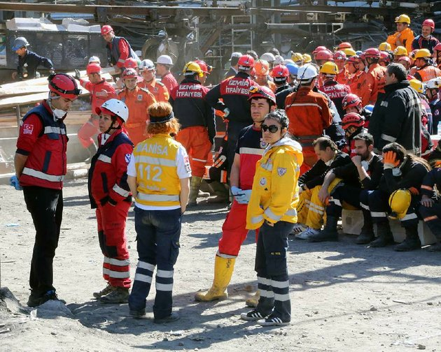 rescue-workers-and-medics-wait-outside-the-coal-mine-in-soma-turkey-thursday-may-15-2014-an-explosion-and-fire-at-a-coal-mine-in-soma-some-250-kilometers-155-miles-south-of-istanbul-killed-hundreds-of-workers-authorities-said-in-one-of-the-worst-mining-disasters-in-turkish-historyap-photoberza-simsek