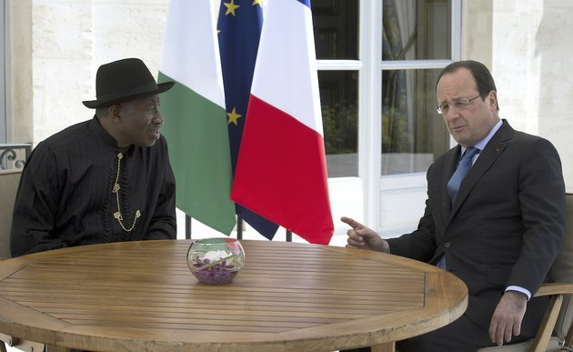 french-president-francois-hollande-right-poses-with-nigeria-president-goodluck-jonathan-during-the-paris-security-in-nigeria-summit-at-the-elysee-palace-in-paris-saturday-may-17-2014-leaders-from-africa-as-well-as-officials-from-the-united-states-britain-and-france-meet-to-coordinate-a-response-to-boko-haram-the-fundamentalist-group-that-abducted-more-than-300-girls-and-is-accused-of-hundreds-of-deaths-in-the-past-year-alone