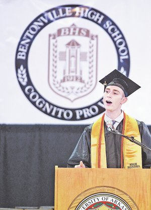 STAFF PHOTO SAMANTHA BAKER • @NWASamantha Dylan Deluca gives the student address to Bentonville High School graduates Saturday at Bud Walton Arena in Fayetteville. Bentonville High School had more than 870 students complete graduation requirements in order to get their diploma.