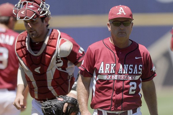 Arkansas coach Dave Van horn heads to the bench during a game against LSU on May 25, 2013 at the SEC Tournament in Hoover, Ala.