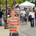 NWA Media/ANDY SHUPE - Zach Finn, 12, of Fayetteville juggles tennis balls during the Block Street B...