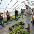 STAFF PHOTO ANDY SHUPE - Jake Melton, farm manager for The Cobblestone Project Farm, right, speaks a...