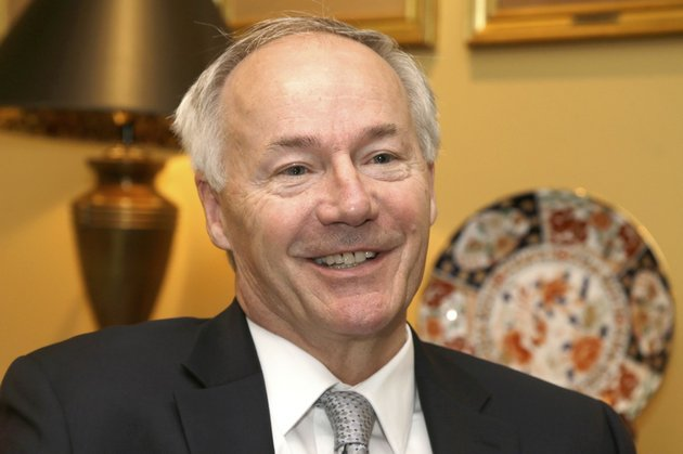 in-this-photo-taken-thursday-may-8-2014-republican-hopeful-in-the-race-for-arkansas-governor-asa-hutchinson-is-interviewed-in-little-rock