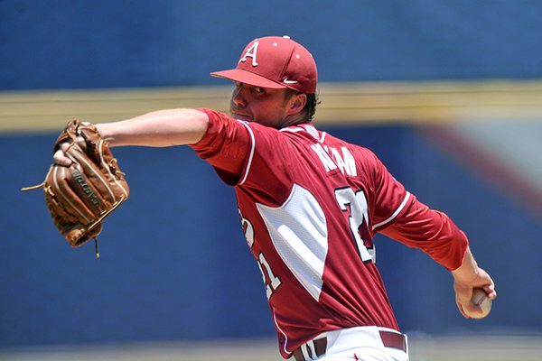 Arkansas pitcher Trey Killian fires a pitch in the second inning of Tuesday afternoon's game against Texas A&M in the 2014 SEC baseball tournament at the Hoover Met in Hoover, Ala.