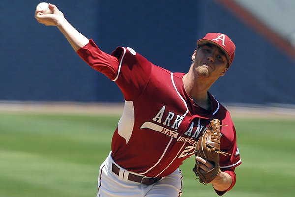 Arkansas' Trey Killian (21) pitches against Texas A&M in the first inning at the Southeastern Conference NCAA college baseball tournament on Tuesday, May 20, 2014, in Hoover, Ala. (AP Photo/Butch Dill)