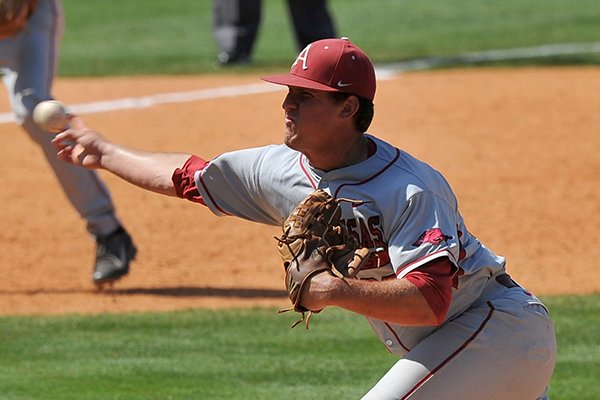 Arkansas pitcher Jacob Stone delivers a pitch during the ninth inning of a SEC Tournament game against Ole Miss on Wednesday, May 21, 2014 at Hoover Metropolitan Stadium in Hoover, Ala.