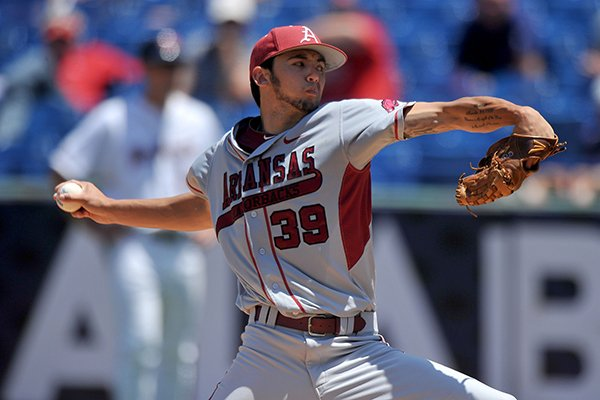 Arkansas pitcher Chris Oliver delivers a pitch during the fourth inning of a SEC Tournament game against Ole Miss on Wednesday, May 21, 2014 at Hoover Metropolitan Stadium in Hoover, Ala.