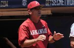 Arkansas coach Dave Van Horn talks from the dugout during the first inning of a SEC Tournament game against Ole Miss on Wednesday, May 21, 2014 at Hoover Metropolitan Stadium in Hoover, Ala.