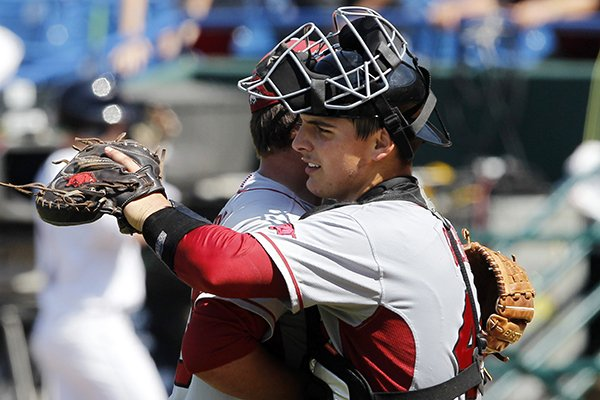 Arkansas' Alex Gosser, right, celebrates with Jacob Stone after Arkansas defeated Mississippi 2-1 at the Southeastern Conference NCAA college baseball tournament Wednesday, May 21, 2014, in Hoover, Ala. (AP Photo/Butch Dill)