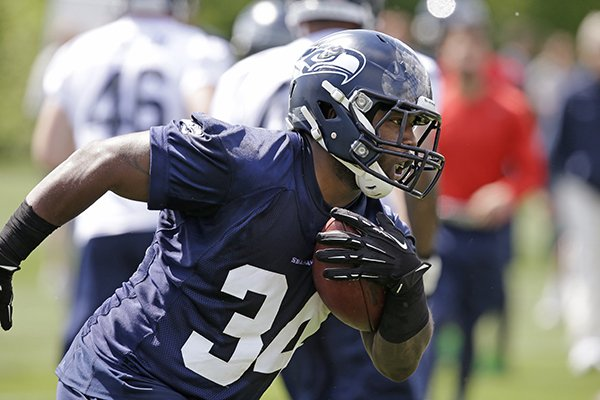 Seattle Seahawks' Kiero Small runs at an NFL football rookie minicamp Saturday, May 17, 2014, in Renton, Wash. (AP Photo/Elaine Thompson)