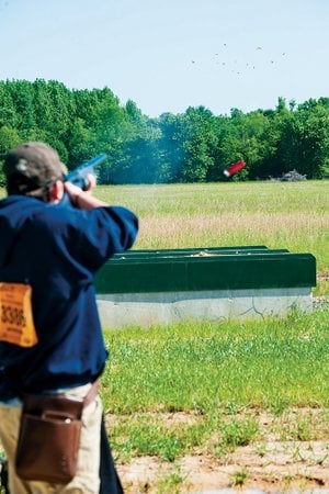 As Jacob Baker takes his shot at the skeet, his shell ejects from his shotgun during competition at the Arkansas Game and Fish Foundation Shooting Sports Complex in Jacksonville.
