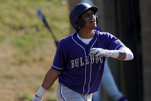 Fayetteville senior Kyle Pate hits a 2-run double during the second inning against Siloam Springs Tuesday, March 18, 2014, at Bulldog Stadium in Fayetteville.