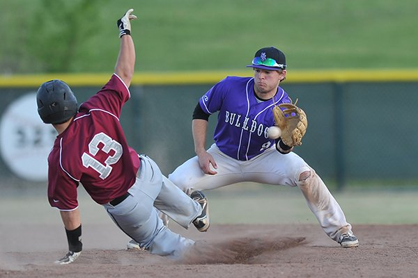 Fayetteville shortstop Drew Tyler tries to put the tag on Springdale base runner Trevor Beadle as he steals second base during the second game of a doubleheader Thursday, May 1, 2014 in Springdale.