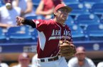 Arkansas third baseman Bobby Wernes makes a throw during a SEC Tournament game against Texas A&M on Tuesday, May 20, 2014 at Hoover Metropolitan Stadium in Hoover, Ala.