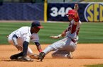 Arkansas first baseman Eric Fisher slides into second base ahead of the tag from Ole Miss shortstop Errol Robinson during the sixth inning of a SEC Tournament game on Wednesday, May 21, 2014 at Hoover Metropolitan Stadium in Hoover, Ala.
