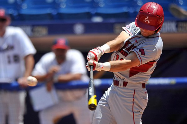 Arkansas outfielder Andrew Benintendi records a single in the fifth inning of a SEC Tournament game against Ole Miss on Wednesday, May 21, 2014 at Hoover Metropolitan Stadium in Hoover, Ala.