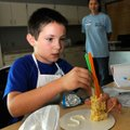 STAFF PHOTO FLIP PUTTHOFF A building made of rice-cereal treats takes shape at the hands of Tommy W...