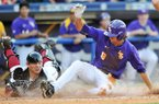 LSU base runner Mark Laird slides across home plate ahead of the tag from Arkansas catcher Alex Gosser during the seventh inning of a SEC Tournament game on Thursday, May 22, 2014 at Hoover Metropolitan Stadium in Hoover, Ala.