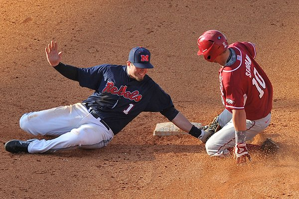 Arkansas' Joe Serrano slides as Ole Miss second baseman Preston Overbey applies a tag during the ninth inning of a SEC Tournament game Friday, May 23, 2014 at Hoover Metropolitan Stadium in Hoover, Ala. Serrano was called safe on the play and later scored the go-ahead run for the Razorbacks.