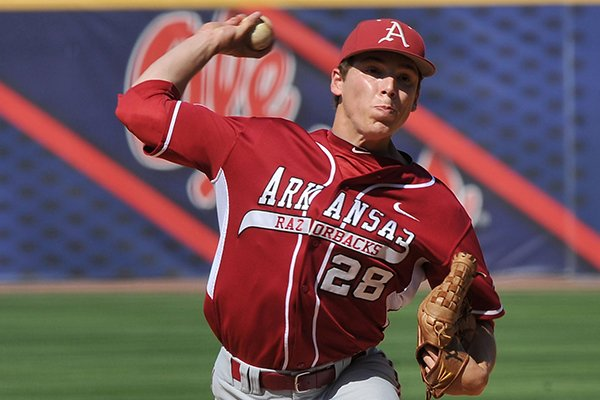 Arkansas pitcher James Teague throws a pitch during a SEC Tournament game against Ole Miss on Friday, May 23, 2014 at Hoover Metropolitan Stadium in Hoover, Ala.