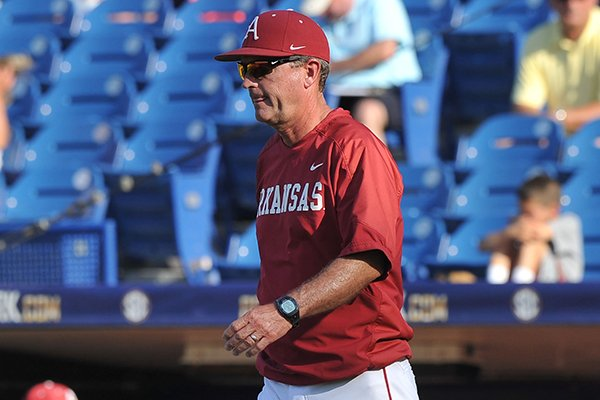 Arkansas coach Dave Van Horn walks toward the mound during a SEC Tournament game against LSU on Thursday, May 22, 2014 at Hoover Metropolitan Stadium in Hoover, Ala.