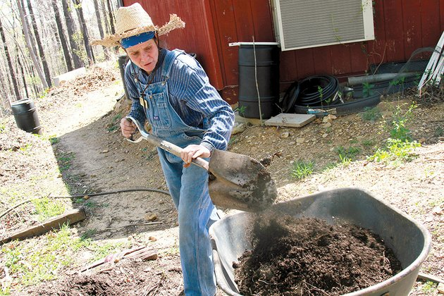 angela-spencerthree-rivers-edition-tina-marie-wilcox-chief-herbalist-and-head-gardener-at-the-ozark-folk-center-gathers-compost-for-some-new-plants-at-the-center-wilcox-works-with-the-on-site-restaurant-to-gather-scraps-for-the-compost-piles
