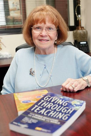 Cathleen Shultz, dean of the Carr College of Nursing at Harding University in Searcy, shows the two books she has written. She has served as dean since 1980 and will step down from the position effective June 1 to take a yearlong sabbatical, then will return to Harding as a full-time professor of nursing.