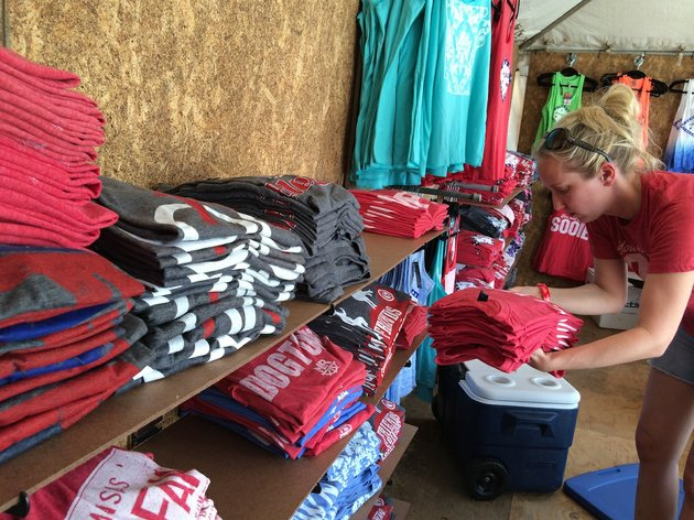 casey-jordan-stacks-shirts-in-the-stated-apparel-booth-at-riverfest-on-friday-the-annual-festival-begins-at-6-pm-and-lasts-through-sunday-evening