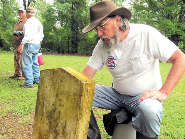 tom-bird-of-the-sons-of-confederate-veterans-works-at-the-dogwood-cemetery-to-refurbish-headstones