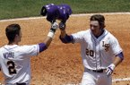 LSU's Conner Hale (20) celebrates with Tyler Moore (2) after hitting a home run against Arkansas during the second inning at the Southeastern Conference NCAA college baseball tournament on Saturday, May 24, 2014, in Hoover, Ala. (AP Photo/Butch Dill)