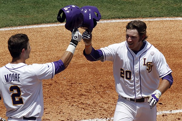 lsus-conner-hale-20-celebrates-with-tyler-moore-2-after-hitting-a-home-run-against-arkansas-during-the-second-inning-at-the-southeastern-conference-ncaa-college-baseball-tournament-on-saturday-may-24-2014-in-hoover-ala-ap-photobutch-dill