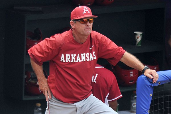 Arkansas coach Dave Van Horn watches from the dugout during a SEC Tournament game against LSU on Saturday, May 24, 2014 at Hoover Metropolitan Stadium in Hoover, Ala.