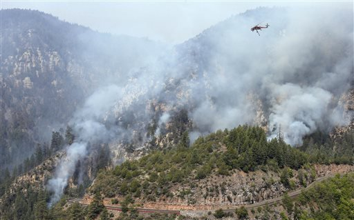 a-heavy-type-1-skycrane-helictoper-flies-over-the-slide-fire-above-the-route-89-a-before-dumping-a-2000-gallon-load-of-water-as-it-burns-up-oak-creek-canyon-on-friday-may-23-2014-near-flagstaff-ariz-the-fire-has-burned-approximately-7500-acres-and-is-five-percent-contained