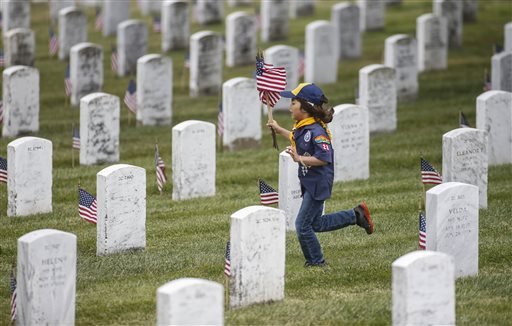 cub-scout-mateo-armijo-7-with-pack-28-in-burlingame-runs-with-flags-at-the-golden-gate-national-cemetery-in-san-bruno-calif-on-saturday-may-24-2014-thousands-of-boy-scouts-cub-scouts-and-girl-scouts-took-part-in-the-annual-event-to-place-117000-tiny-flags-on-the-graves