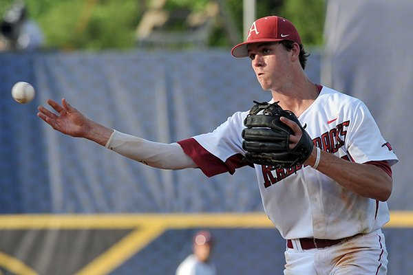 Arkansas second baseman Brian Anderson throws the ball during the seventh inning of a SEC Tournament game against LSU on Thursday, May 22, 2014 at Hoover Metropolitan Stadium in Hoover, Ala.