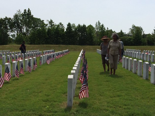 families-walk-through-the-rows-of-tombstones-at-the-arkansas-state-veterans-cemetery-on-memorial-day