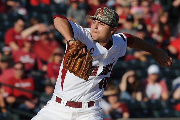 Arkansas starter Jalen Beeks delivers a pitch against Vanderbilt during the first inning Saturday, April 19, 2014, at Baum Stadium in Fayetteville.