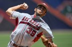 Arkansas pitcher Chris Oliver delivers a pitch during a SEC Tournament game against Ole Miss on Wednesday, May 21, 2014 at Hoover Metropolitan Stadium in Hoover, Ala.